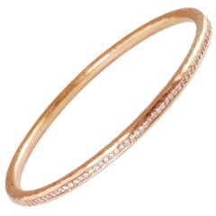 18 Carat Rose Gold Hammered channel set diamond bangle