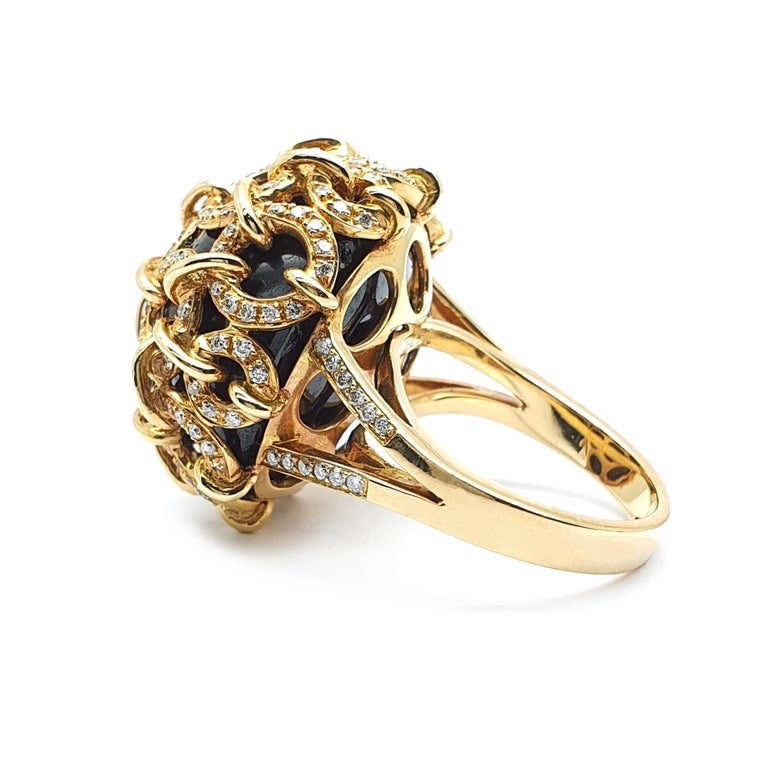 An 18K Rose gold ring with onyx held by rings occupied with 0.84ct brilliantly cut diamonds colour w and clarity VVS Rose gold weight is 21.30 grams