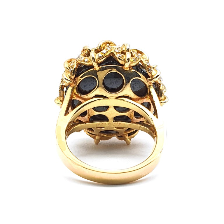 Rose Cut 18 Carat Rose Gold Ring with Onyx held by Rings Occupied with Diamonds For Sale