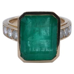 18 Carat Rose/Yellow Gold Emerald Cut Emerald and High Quality Diamond Ring