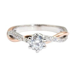 18 Carat White and Rose Gold 0.50 Carat Round Diamond Crossover Engagement Ring