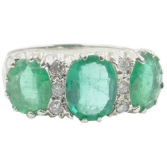 18 Carat White Gold 3 Emerald and Diamond Bridge Ring