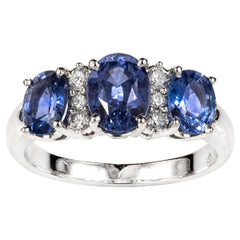 18 Carat White Gold and Oval Ceylon Sapphire and Brilliant Cut Diamond Ring