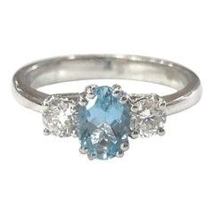 18 Carat White Gold Aquamarine and Diamond Three-Stone Ring