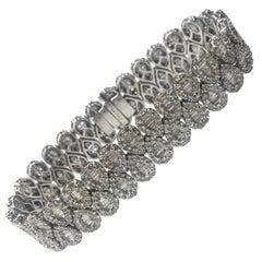18 Carat White Gold Baguette and Round Brilliant Cut Diamond Bracelet