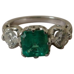 18 Carat White Gold Emerald and Diamond 3-Stone Ring