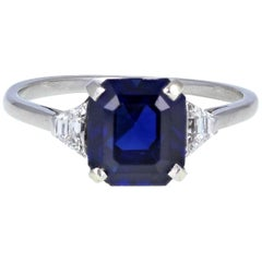 18 Carat White Gold Emerald Cut Blue Sapphire Diamond Three-Stone Ring