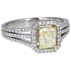 18 Carat White Gold GIA Certificated Fancy Yellow Diamond Halo Engagement Ring