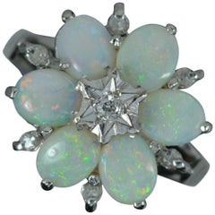 18 Carat White Gold Natural Opal and Diamond Snowflake Cluster Ring
