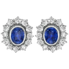 18 Carat White Gold Oval Ceylon Sapphire and Diamond Cluster Stud Earrings