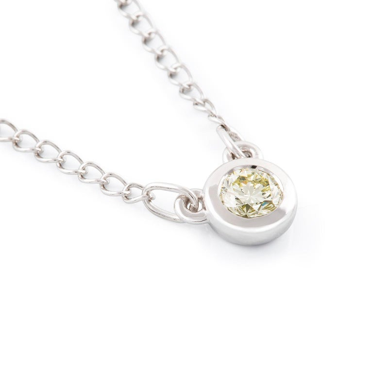Diamond Necklace  This gorgeous petite pendant features a stunning  diamond. The circular setting is suspended from an elegant curb chain.  Round brilliant cut diamonds:Fancy Yellow color, SI clarity, 0.40 Carat diamond weigh  Weight: 3.60