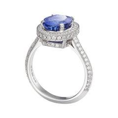 18 Carat White Gold, Sapphire and Diamond Halo Ring
