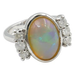 18 Carat White Gold Solid Opal and Diamond Ring