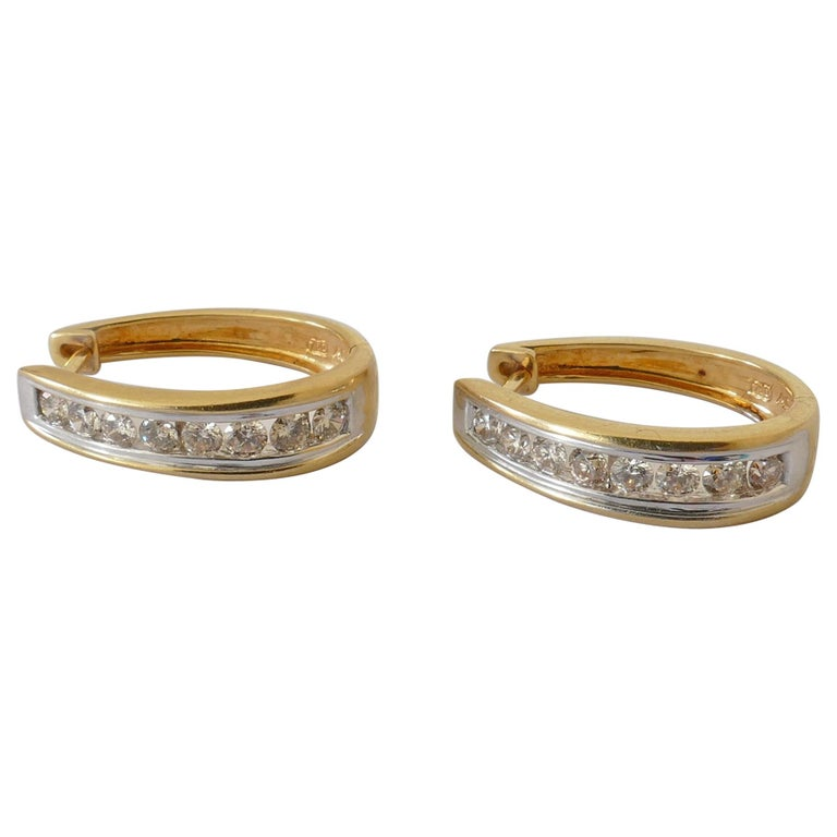 18 Carat Yellow and White Gold Oval Huggie Style Diamond Earrings For Sale