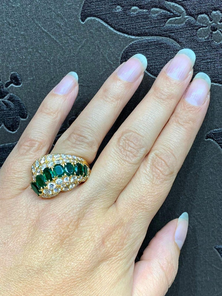 Oval Cut 18 Carat Yellow Gold Emerald and Diamond Cocktail Ring For Sale