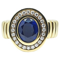 18 Carat Yellow Gold Flex Ring with an Oval sharpened Sapphire of 3.52 Carat