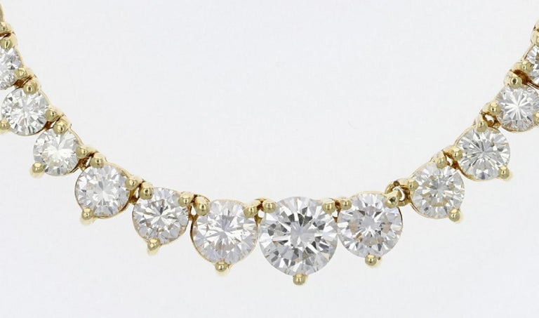 Spectacular riviera necklace with 18 carats of high quality diamonds! This is quite a fantastic piece that is beaming with brilliance and luxury! The sizes and quality is incredible and is certainly above average compared to most necklaces.