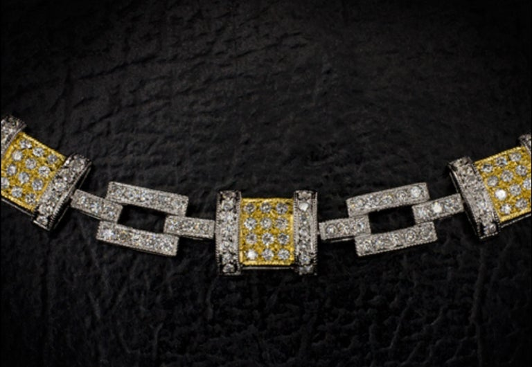 Exquisite tennis bracelet with two tones of gold and 2.50 carats of diamonds! The piece is full of gorgeous sparkle and it has a unique geometric design.   Over 300 fully faceted round cut diamonds are perfectly set in this alluring bracelet and we