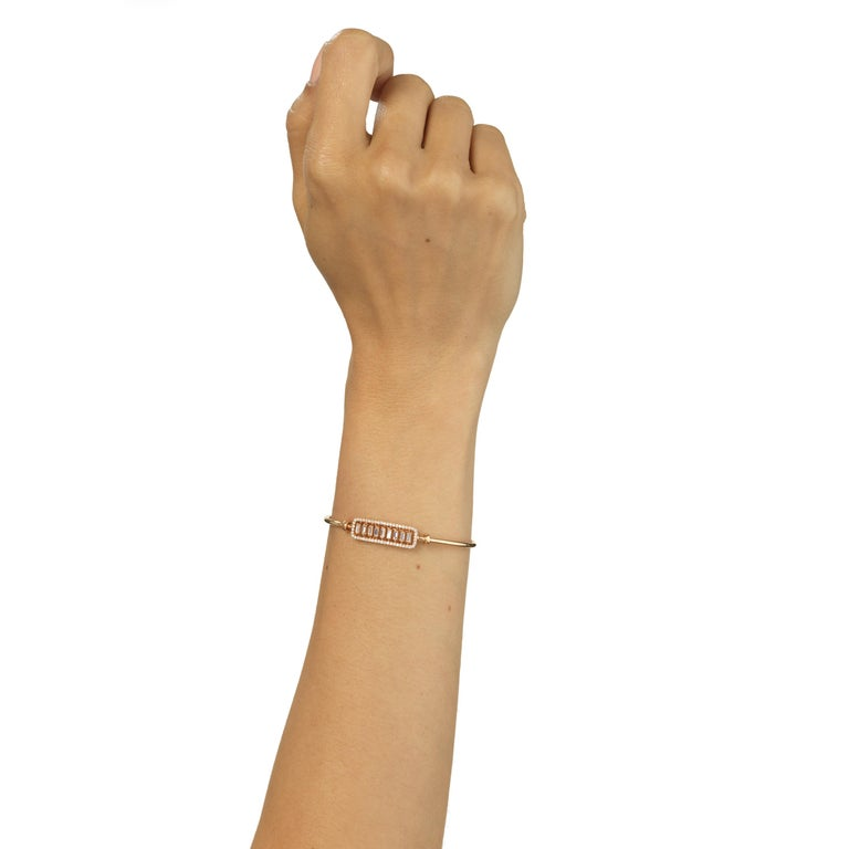 This 18 Karat rose gold bracelet takes elegance up a notch. Featured with 9 individually set baguette diamonds framed within 50 pave round diamonds. It comes with a latch lock for safety.