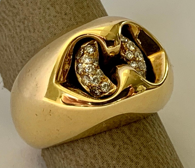 18k yellow Gold Diamond Ring by Bulgari.  Set with round brilliant cut diamonds VS1 clarity, G color total weight approximately 0.25 ct. Stamped Hallmarks: Bvlgari 750 Made In Italy.  The ring is currently size european size 51/11. Approximate ring