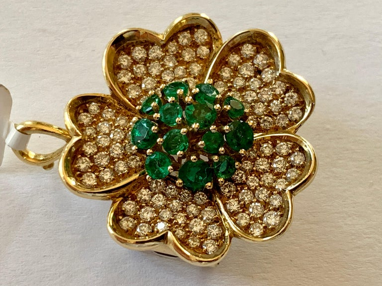 Contemporary 18 Karat Yellow Gold Emerald and Diamond Flower Brooch/Pendant For Sale