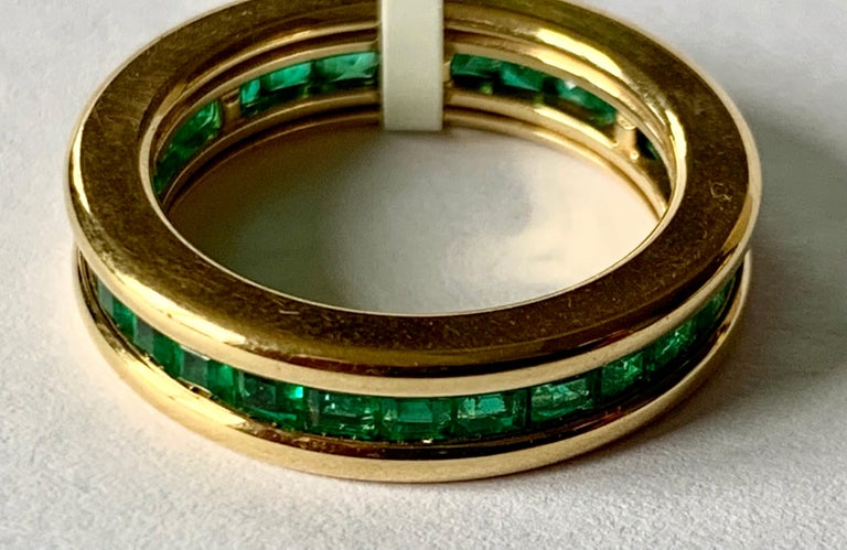 A 18 K yellow Gold Emerald eternity ring. The emeralds weighting 1.88 ct are set in a solid channel setting.  Ring fits a ring size 53/13 and can only be resized to a smaller ring size.  US ring size 6! This is especially nice when worn together