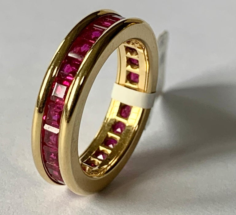 18 K yellow Gold Ruby eternity ring. The rubies weighting 3.39 ct are set in a solid channel setting.  Ring fits a ring size 54/14and can only be resized to a smaller ring size. US size 7! This is especially nice when worn together with another
