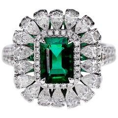 18 Karat 1.55 Carat Vivid Green Emerald and Diamond Solitaire Ring