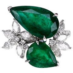 18 Karat 6.67 Carat Soothing Green Emerald and 1.35 Carat Diamond Ring