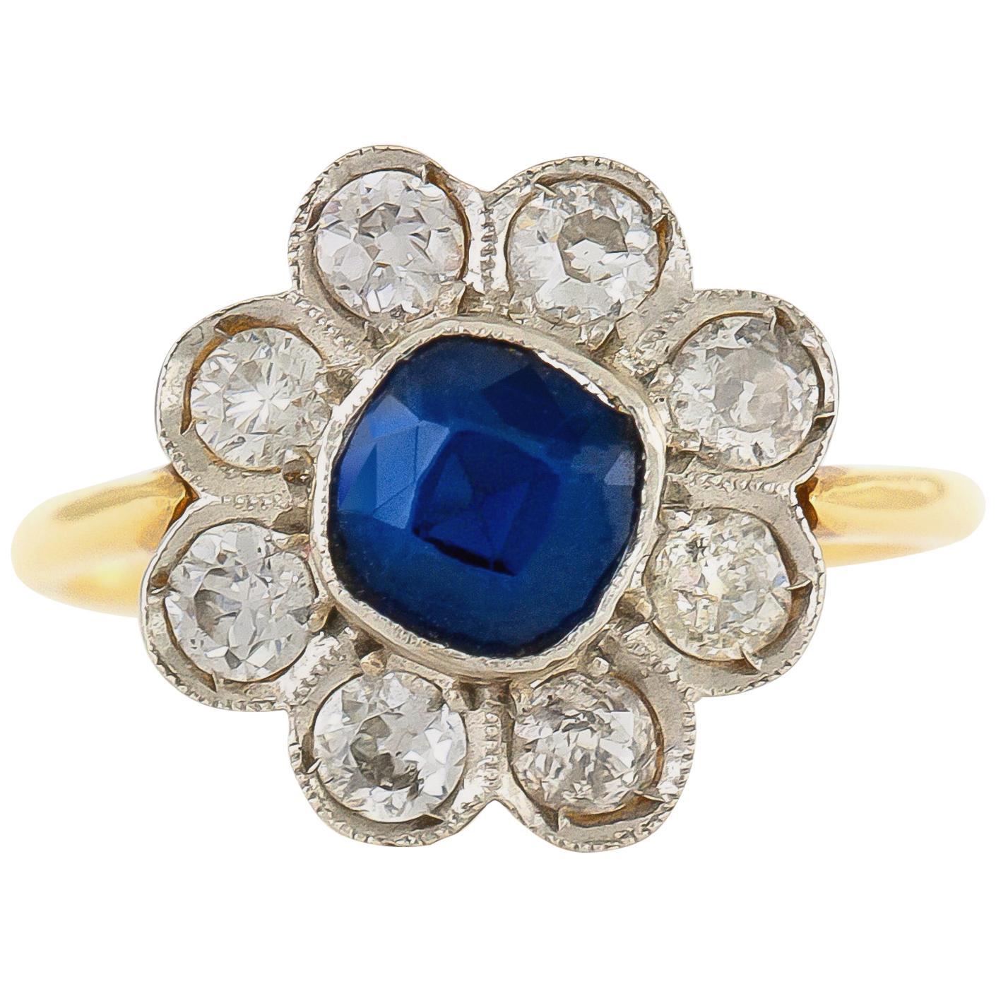 18 Karat and Platinum Flower with Sapphire and Diamonds Ring