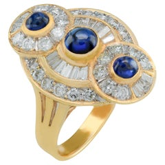 18 Karat Baguette and Round Diamond Cabochon Sapphire Ring