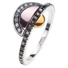 18 Karat Black Gold Ring with Black and White Diamonds