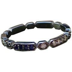 18 Karat Black Rhodium Eternity Band 0.12 Carat of Diamond and Chatham Sapphire