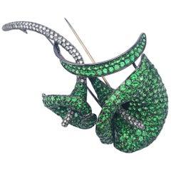 18 Karat Blackened Gold Calla Lily Brooch with Diamonds and Green Garnets