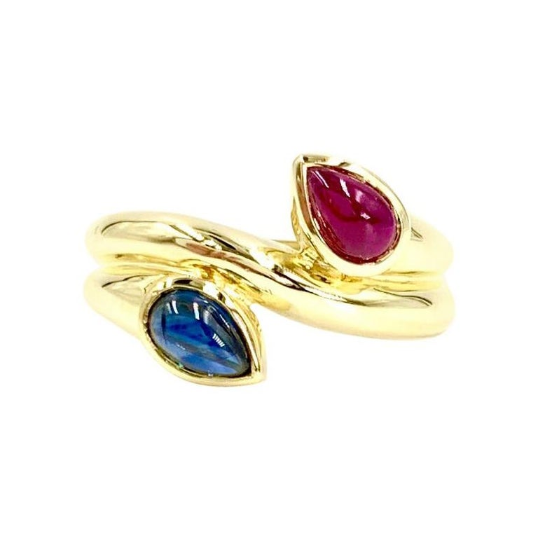 18 Karat Blue Sapphire and Ruby Moi Et Toi Bypass Ring For Sale
