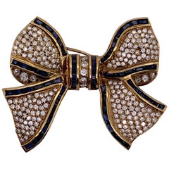 18 Karat Bow Brooch Pin Diamonds and Sapphires Designed in Yellow Gold
