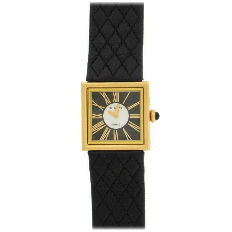 18K yellow gold Chanel women's Mademoiselle wristwatch, made in 1989, with original unworn matelasse leather strap and 18K clasp, three-color black, mother-of-pearl and gold dial with gilt Roman numeral hours, sapphire crown. The 23mm square case