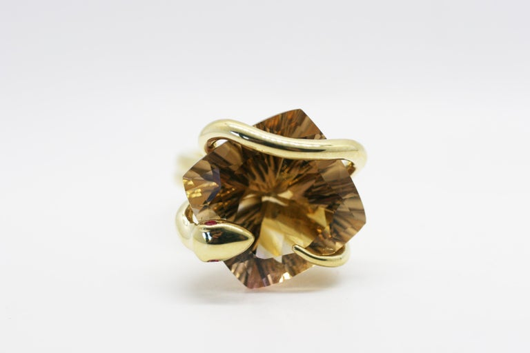 18k Yellow Gold Citrine Climbing Snake Ring features Perez Bitan's signature curved snake with ruby eyes that wraps around the finger and sets the custom cut color changing natural citrine in place  18k Yellow Gold, Rubies 17.35 ct concave facets on