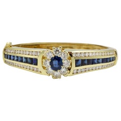 GIA Certified 18 Karat Diamond and Blue Sapphire Hinged Bangle Bracelet