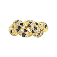18 Karat Diamond and Blue Sapphire Twisted Ring