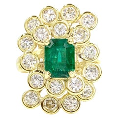 18 Karat Diamond and Emerald Swirl Cocktail Ring
