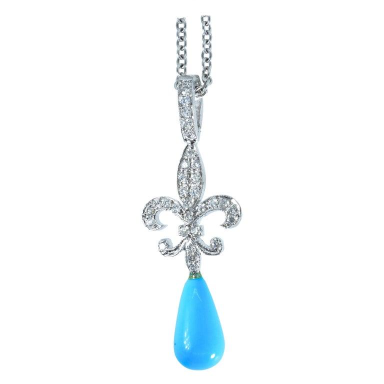 18 Karat Diamond and Turquoise Fleur de Lis Pendant For Sale