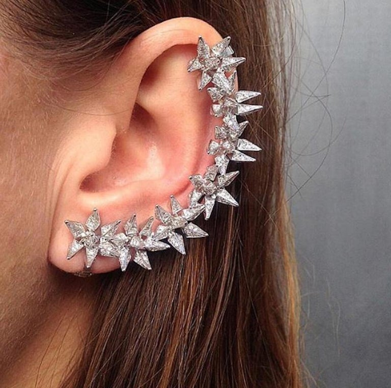 Diamond Eclipse Spike Ear Cuff features Karma El Khalil's signature geometric spike hedgehog motif shaped in a linear pattern to frame the edge of the ear set in 18k White Gold with pave white diamonds Includes two 18k White Gold ear clips to secure