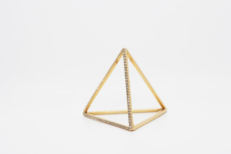 18k Yellow Gold Pyramid Ring features Perez Bitan's signature tetrahedron that sits over the knuckle with white diamond pave on one side of the pyramid Available in 18k Yellow, White or Rose Gold