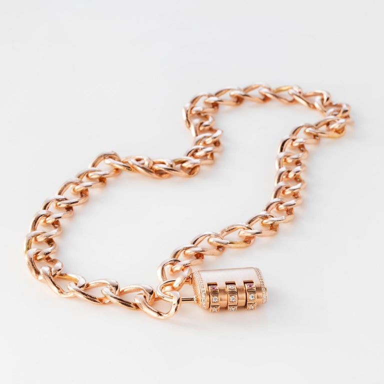 18k Padlock Pendant Necklace features a solid 18k Rose Gold removable padlock pendant with pave White Diamonds throughout and white diamonds and pink sapphires on the dial, and a custom code that locks and unlocks the pendant onto the solid 18k Rose