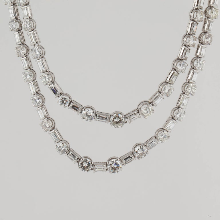 This necklace is crafted in 18K white gold and is a Riviera style.  There are eighty-four (84) round diamonds totaling 30.30 carats; fifty-one (51) baguette diamonds totaling 10.30 carats and two (2) trillion diamonds totaling 0.20 carats.  Total