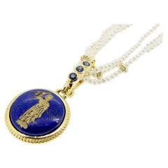 18 Karat Engraved Lapis Lazuli and Sapphire Pendant