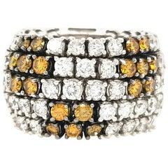 18 Karat Flexible Yellow-Orange Diamond and White Diamond Band White Gold