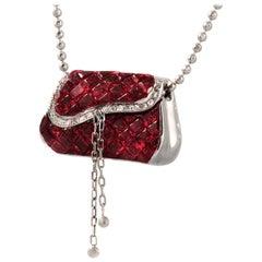 18 Karat Gold 0.11 Carat Diamonds 606 Carat Invisible Set Ruby Purse Necklace
