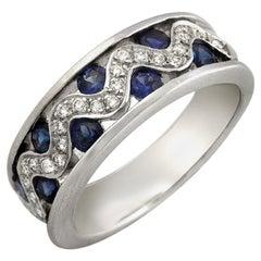 18 Karat Gold 0.26 Carat Diamonds and 1.20 Carat Blue Sapphire Wedding Band Ring